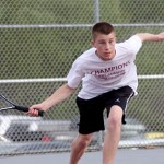 Naugatuck's Jake Morrissey reaches for the ball during a singles match against Crosby May 9. - PHOTO BY LARAINE WESCHLER